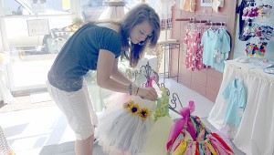 INFANT CLOTHES: Jessica Theriot, pictured above offers a variety of boys and girls children's clothing at Jessie Rae's Baby Bottoms Boutique, including handmade tutus.  The business also offers embroidery. Photo by Cassandra Favre