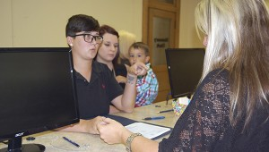 LEGAL FILING: Jenna Lockwood and Whitney Brown gave deputy clerk Lisa Graves their marriage license on Wednesday officially marking the first same-sex marriage license to be recorded in Pearl River County. Photo by Jeremy Pittari