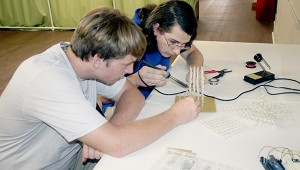 LEARNING SKILLS: From left Picayune Make members Leland Thomas and Luc Lagard work on an LED cube. Photo by Jeremy Pittari