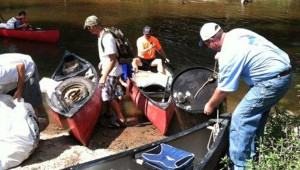 CLEAN CREEK: In this file photo from last year's Boley Creek cleanup, volunteers remove all kinds of debris from the Hobolochitto Creek such as tires and 50-gallon drums.  Another cleanup event has been set for October. File photo
