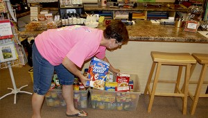 Melinda Shaw, owner of Melinda's Fine Gifts and More, collects food every year for the food banks in PIcayune.  Photo by Cassandra Favre