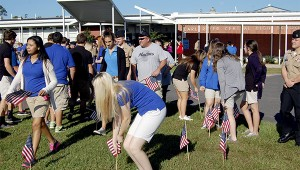 Photo by Cassandra Favre The students at Pearl River Central High School remembered the lives lost during the 9/11 attacks on the World Trade Center in New York City in 2001. After the ROTC lowered the flag half staff, students were invited to place American Flags in the ground around.