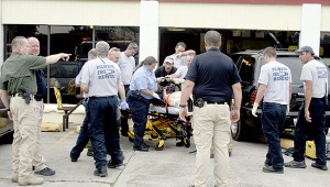 Emergency personnel tend to the injured in Thursday' accident. Photo by Jeremy Pittari