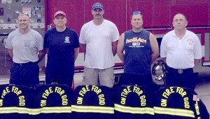 """UP FOR THE CHALLENGE: From left in the photo above is Donny Leonard Sr., Steve Seal, Ronnie Reynolds, Tony Scharenbrock and Chris Banks, who are part of the competitive firefighter team """"On Fire for God."""" They headed to Texas this weekend to compete in the Scott Firefighter Combat Challenge. Submitted Photo"""