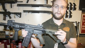 HOMEMADE: Tavish Kelly of Kelly Firearms near Picayune shows off one of the guns they make at the business, an AR-15 rifle. Photo by Jeremy Pittari