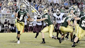 HAND OFF: Poplarville quarterback Clay Garrett hands the ball off to Anthony Martin. Martin scored two touchdowns during Friday's game against the Long Beach Bearcats.  Photo by Jeremy Pittari