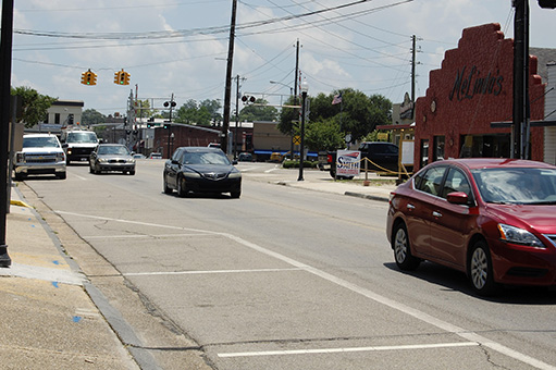 STATE LAW: Traffic moves along West Canal Street.  The sheriff's department encourages residents to report suspected cases of illegal tags to the department. Photo by Ashley Collins.