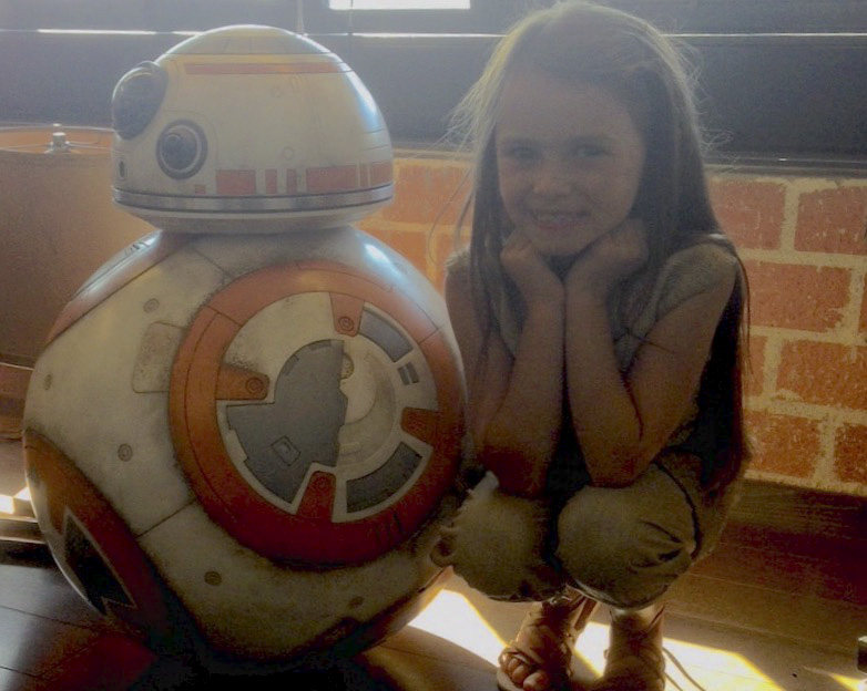on set: Cailey Fleming poses with BB-8 at Bad Productions headquarters in Los Angeles, California.  Photo submitted