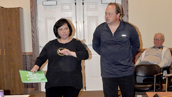 ENVIRONMENTALLY SOUND: From left, Brandie and Robert Renskowski address the Poplarville Board of Aldermen about the curbside recycling service program during Tuesday's meeting.  Photo by Cassandra Favre