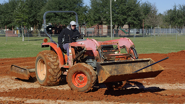 Jesse Wright | Picayune Item prep work: Jerry Todd with the Picayune Parks Department works on a softball field at Friendship Park.