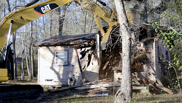 A long-abandoned house on N. Abrams Ave. was demolished by the Picayune Public Works Department on Friday. Photo by Julia Arenstam